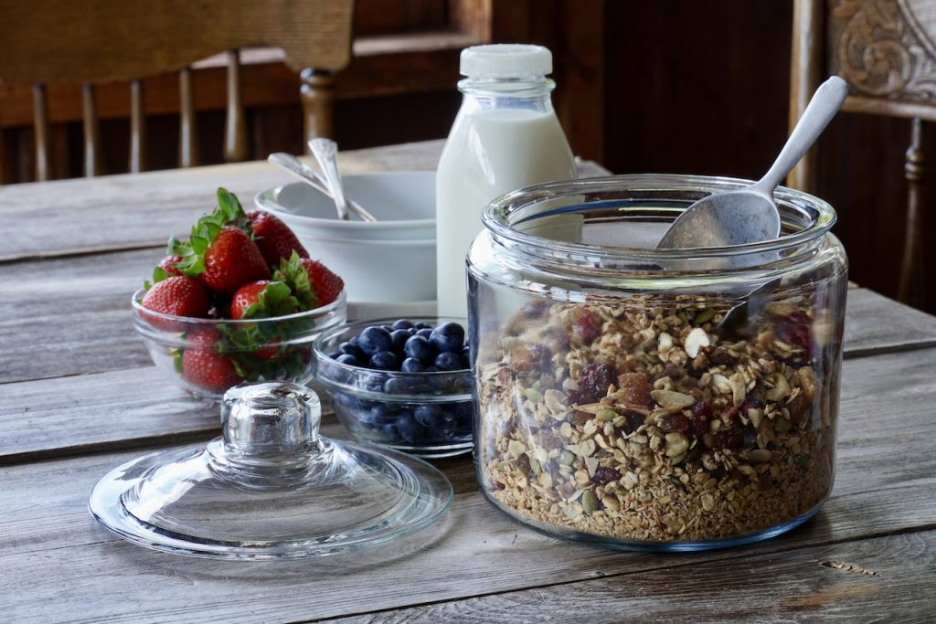 A large canister of the granola