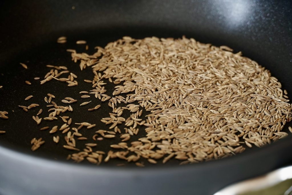 Cumin seeds toasting in the skillet
