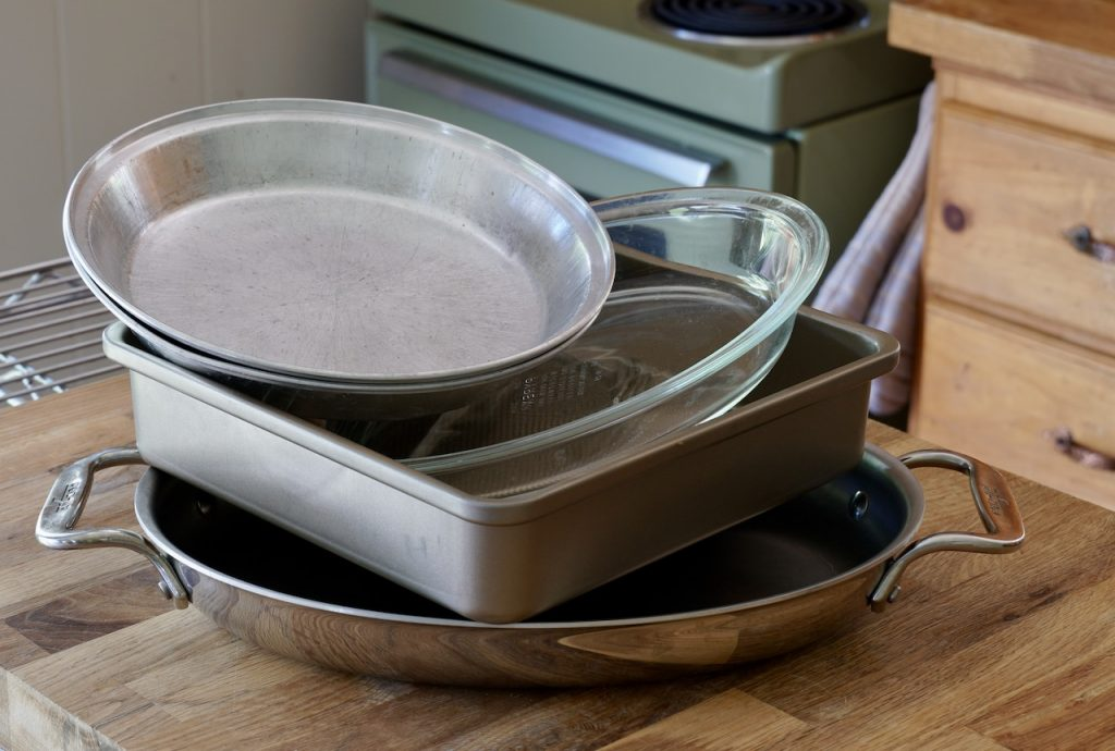 An assortment of pans in which to bake the cinnamon buns