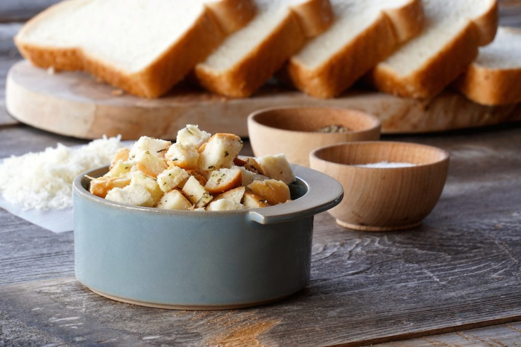 Homemade garlic croutons in a small bowl