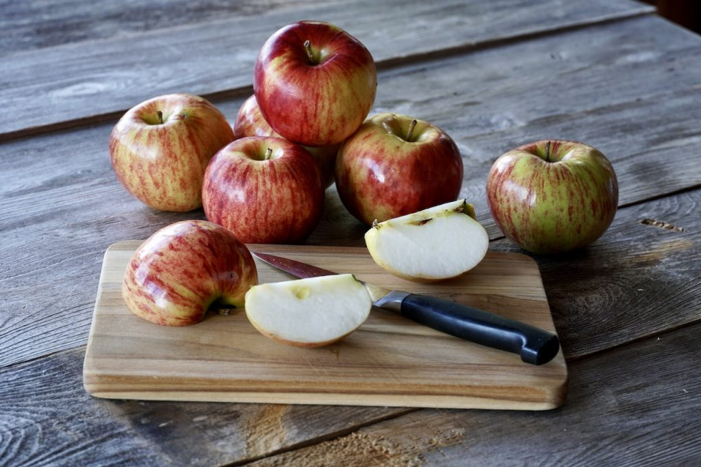 Tart apples ready to be peeled, cored and sliced for the recipe