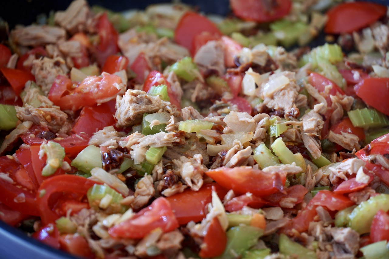 Tuna, tomatoes, onion, celery and capers sautéed in a large skillet