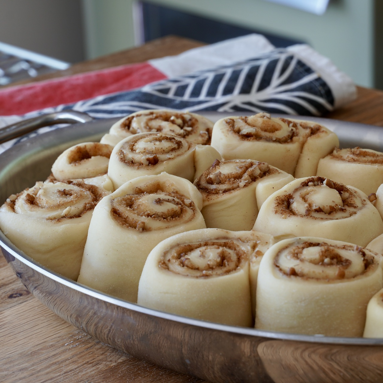 The cinnamon rolls after they've risen