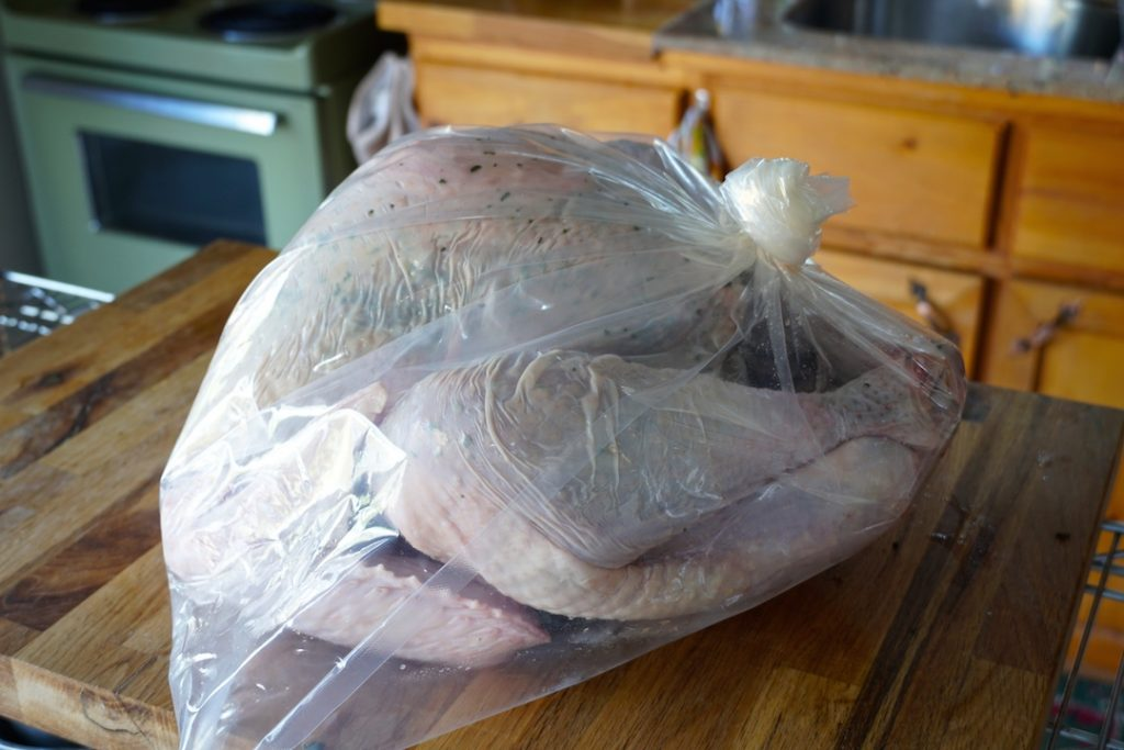 The turkey rubbed with the herbs and salt tied up in a heavy duty bag, ready to marinate
