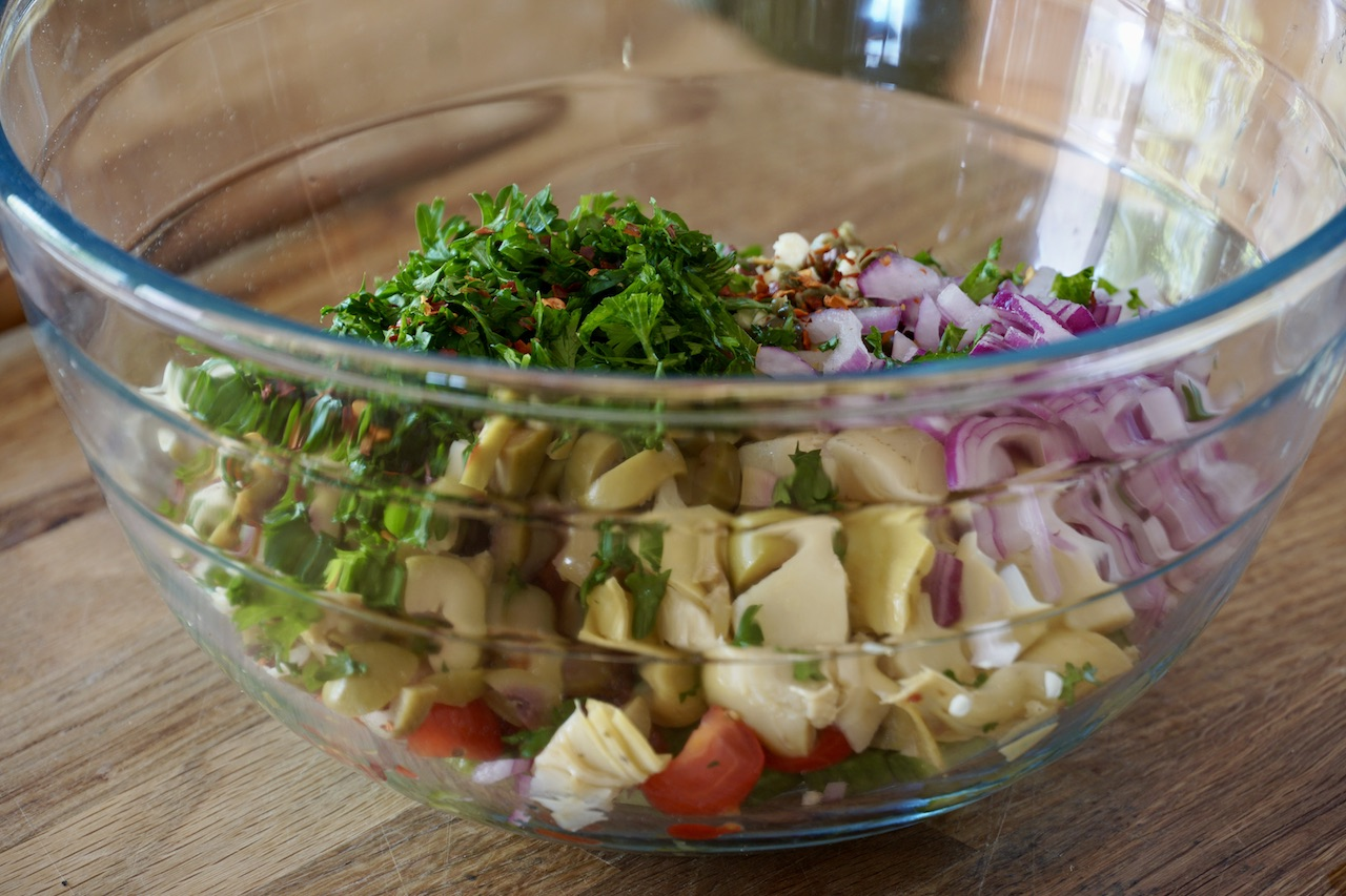 All of the ingredients for the salad in a large bowl