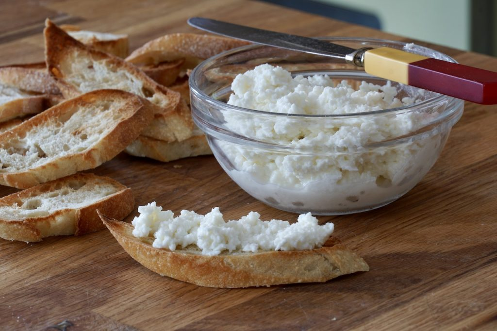 Ricotta cheese spread on toasted slices of French baguette