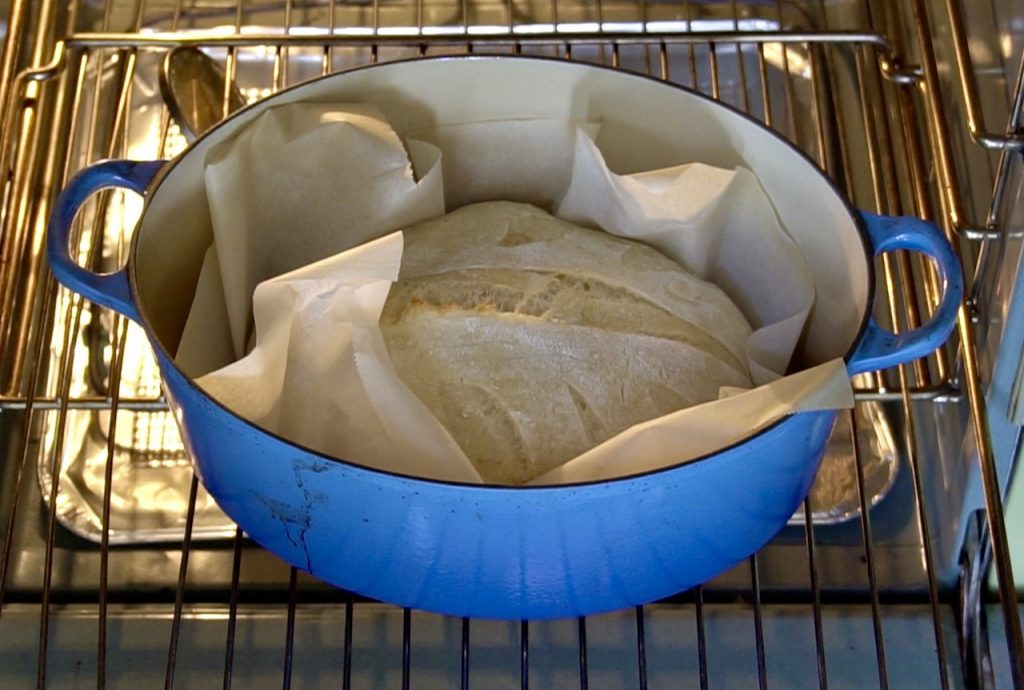 Removing the lid from the Dutch oven
