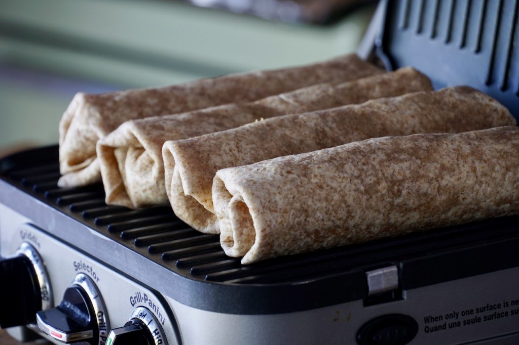 The breakfast wraps on the griddle