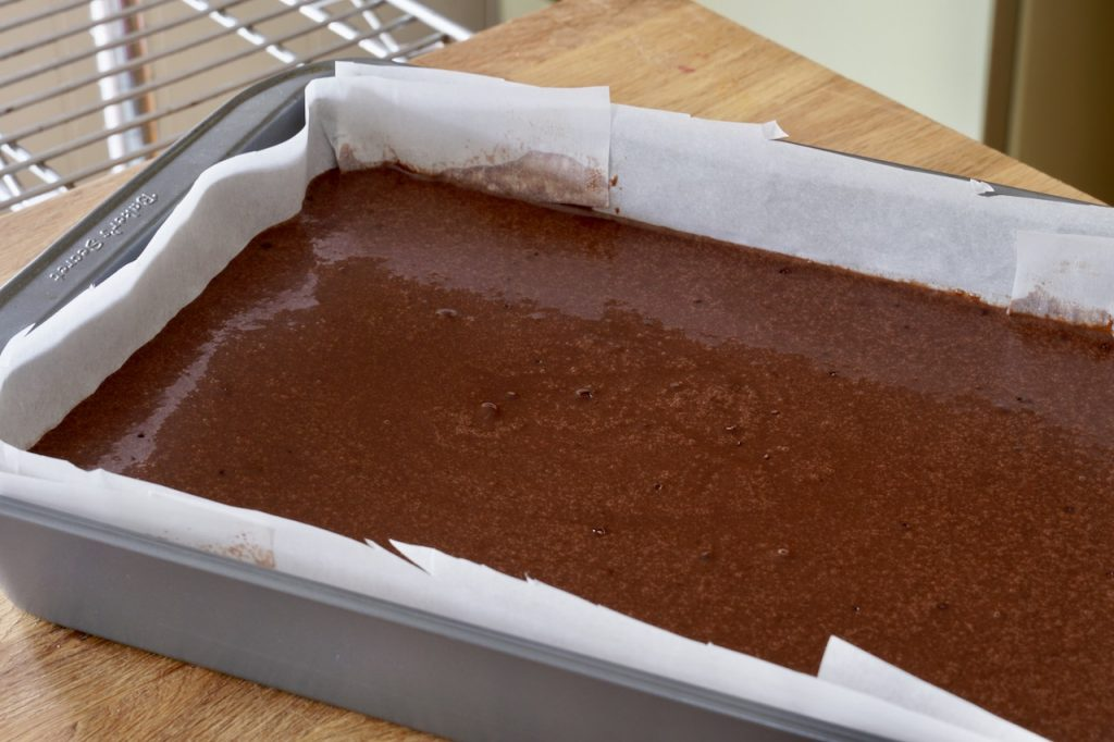 The cake batter poured into the baking pan