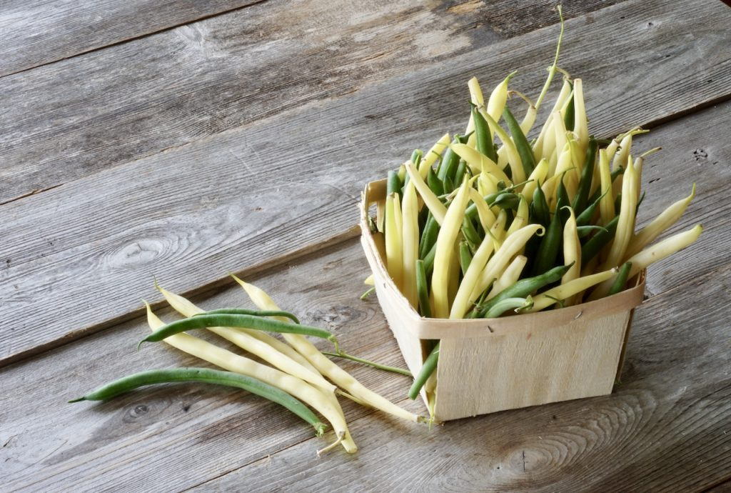 A mix of yellow and green runner beans