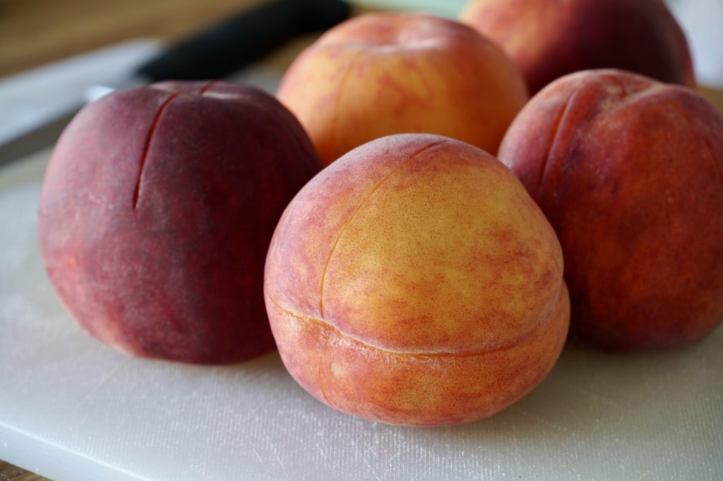 The bottoms of the peaches scored