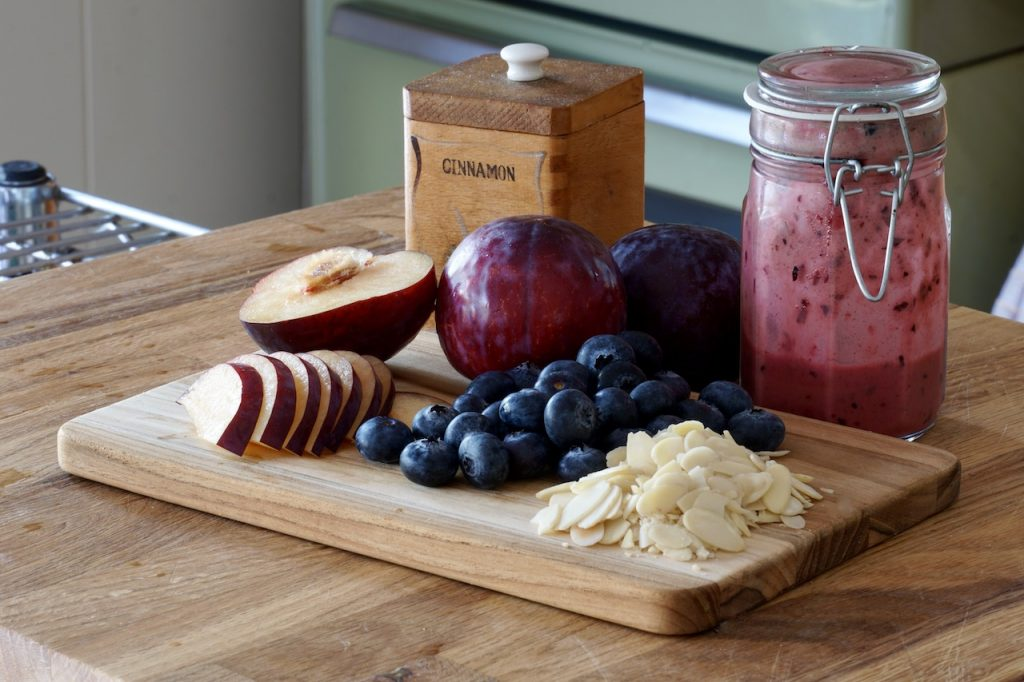 Plums, blueberries, sliced almonds and the remaining dressing
