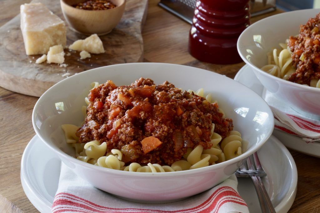 A bowl of pasta topped with the meat sauce