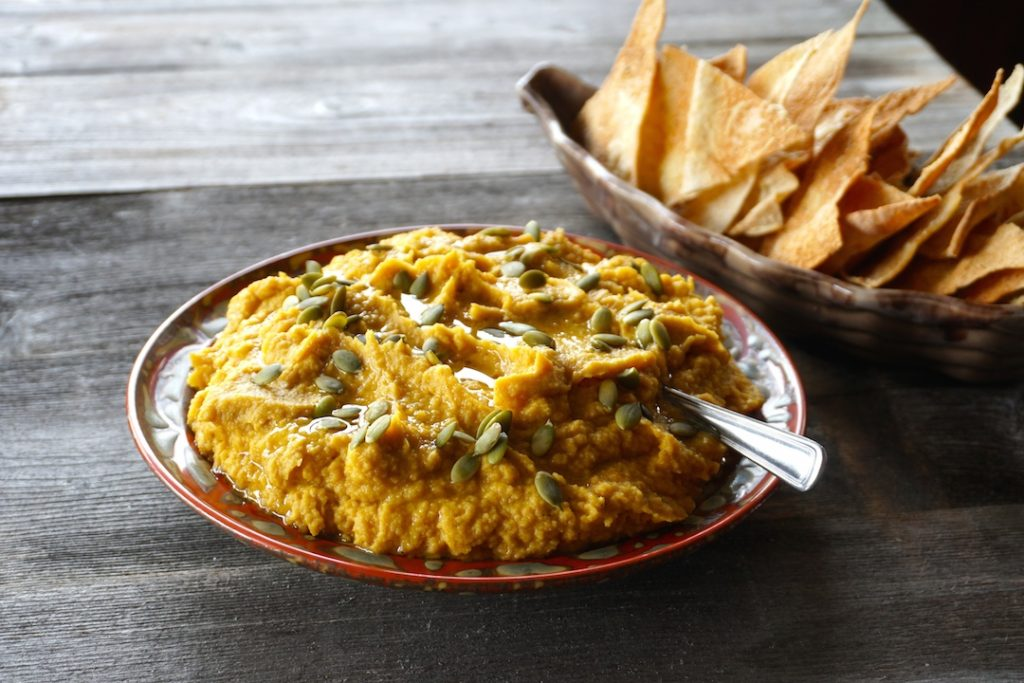 Roasted Pumpkin Hummus served with crunchy pita crisps