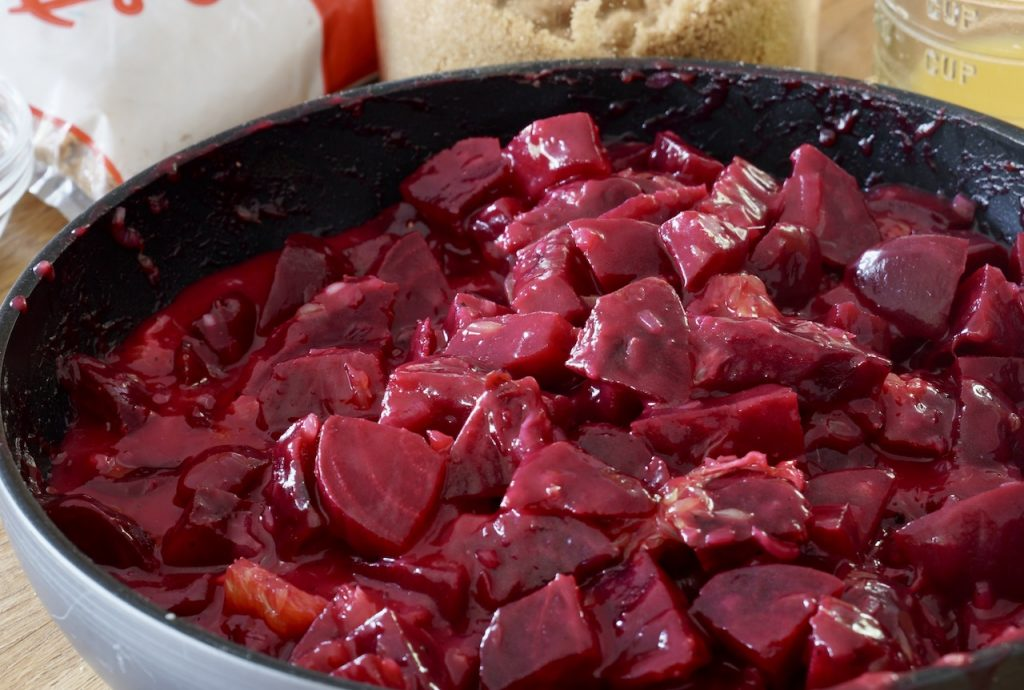 The beets mixed up with the sauce and oranges
