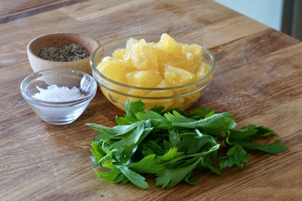A garnish of chopped orange, parsley, salt and pepper