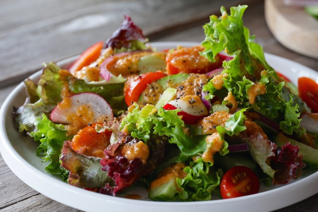 A salad topped with the Best Japanese Salad Dressing