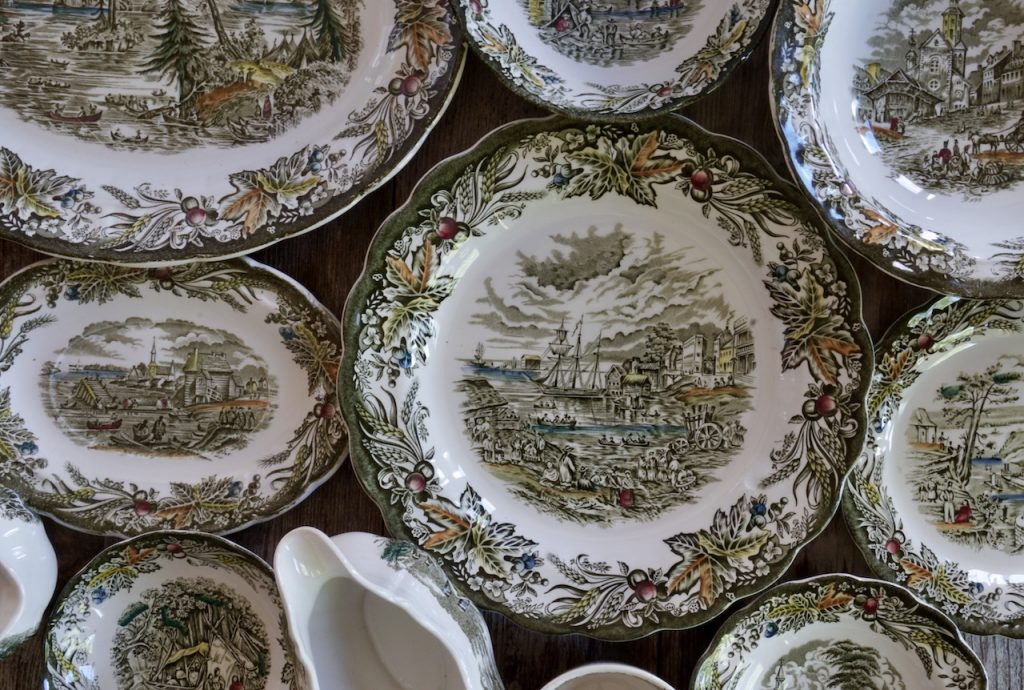 The various images on the different pieces of china