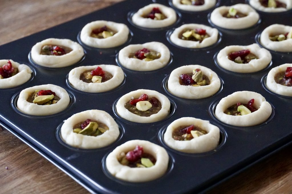 The mini tarts filled and ready to be baked