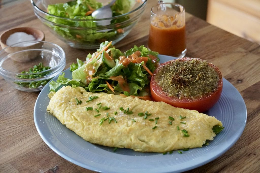 The Perfect Omelette served with salad and a grilled tomato