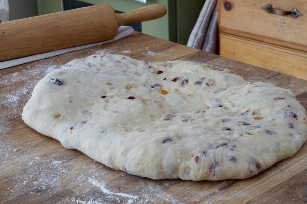 The dough kneaded with the dried and glazed fruit