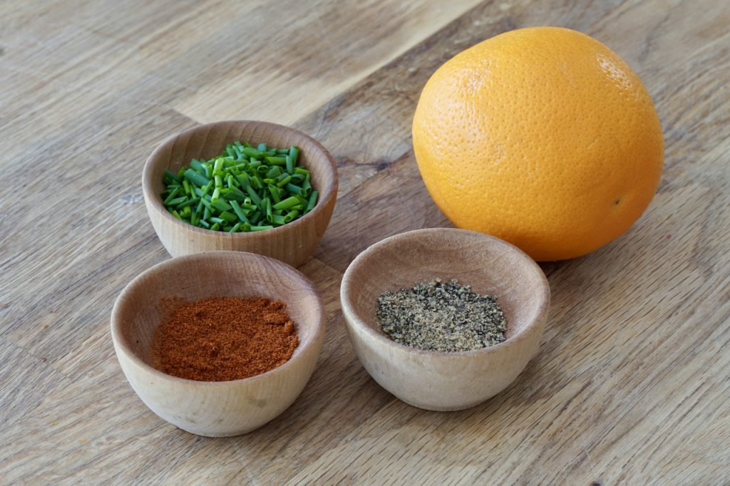 Orange, paprika, chives and black pepper to garnish the eggs benny