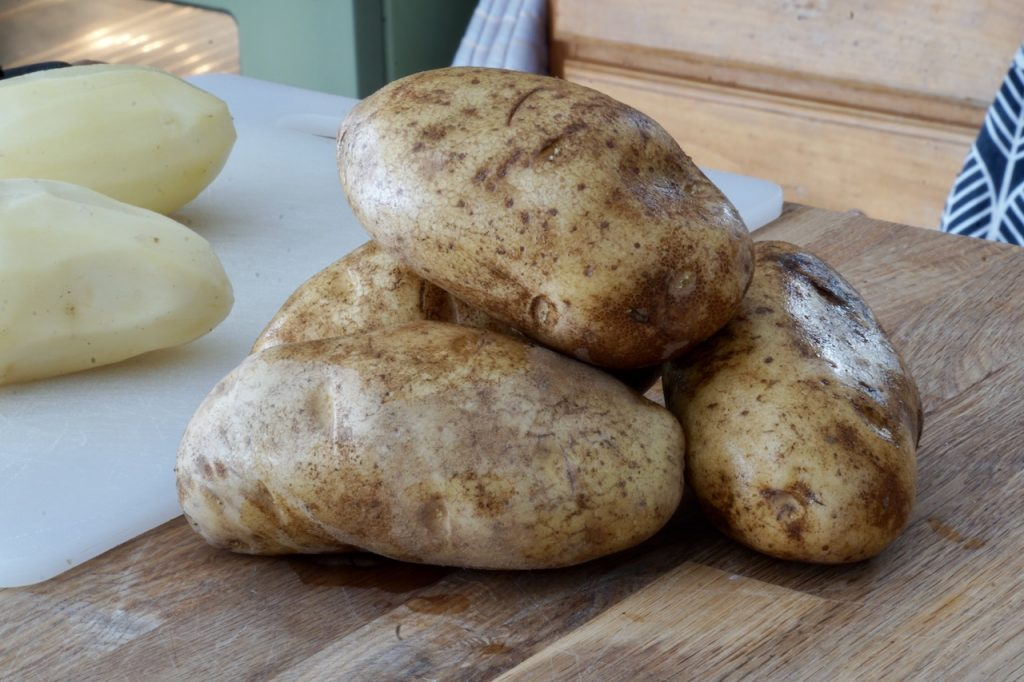 Russet potatoes ready to be peeled