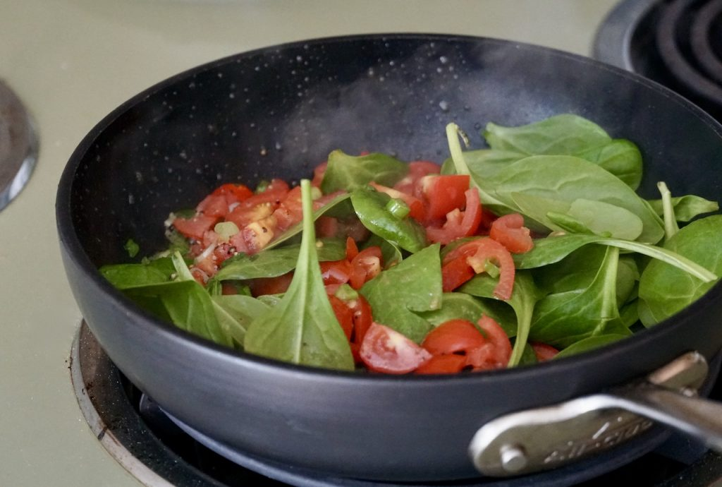 Baby spinach, cherry tomatoes and green onions sautéed in butter
