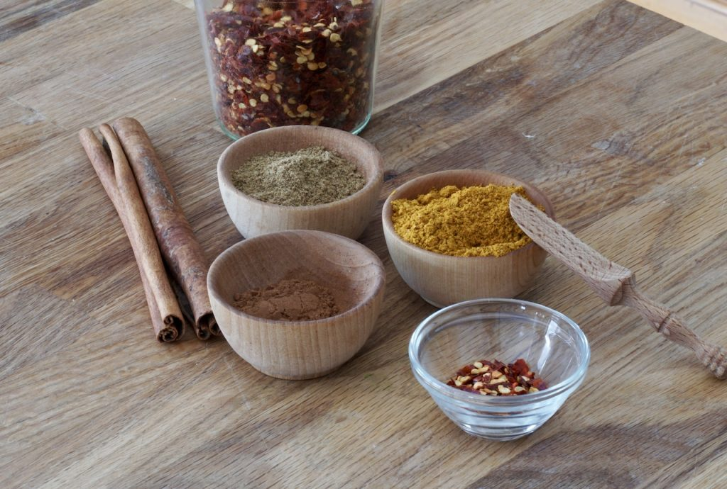 Curry powder, cinnamon, cumin and chili flakes