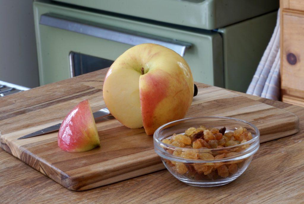 Apple and golden yellow raisins