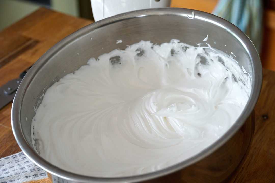 the finished frosting cooling a bit in a bowl