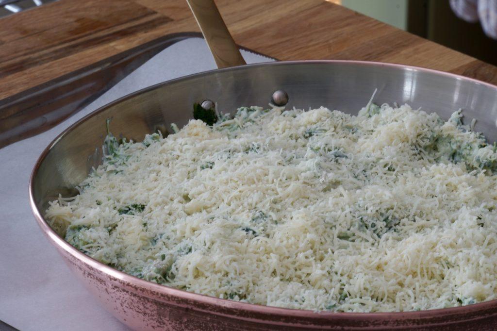 The dip sprinkled with Parmesan