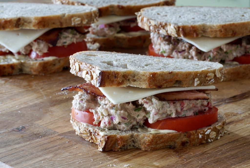The tuna melt sandwiches assembled and ready to be grilled