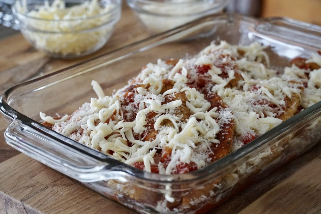 All of the elements for the dish layered in an oven-safe casserole dish