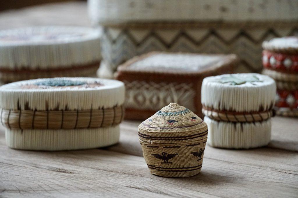A very small basket handmade using sweetgrass