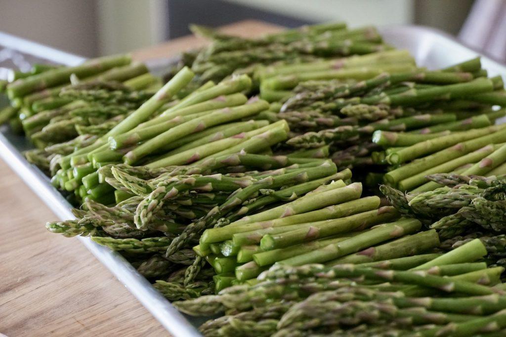 Fresh asparagus divided in half