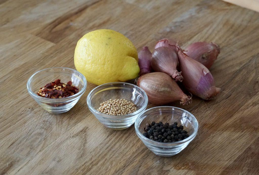 Mustard seeds, black peppercorns, chili flakes, shallots and lemon