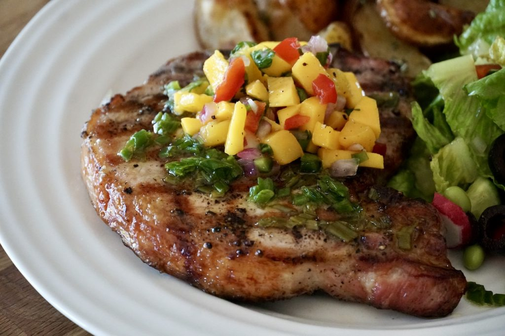 Easy Grilled Pork Chops topped with Tangy Mango Salsa