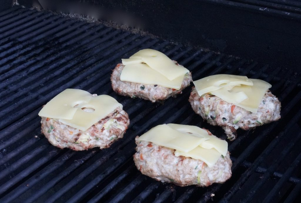 The Emmental cheese melting on the burgers