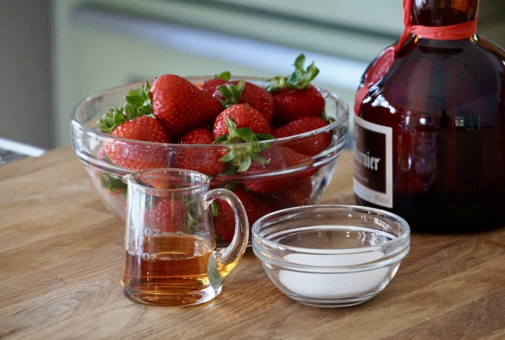 Orange liqueur and sugar for the berries