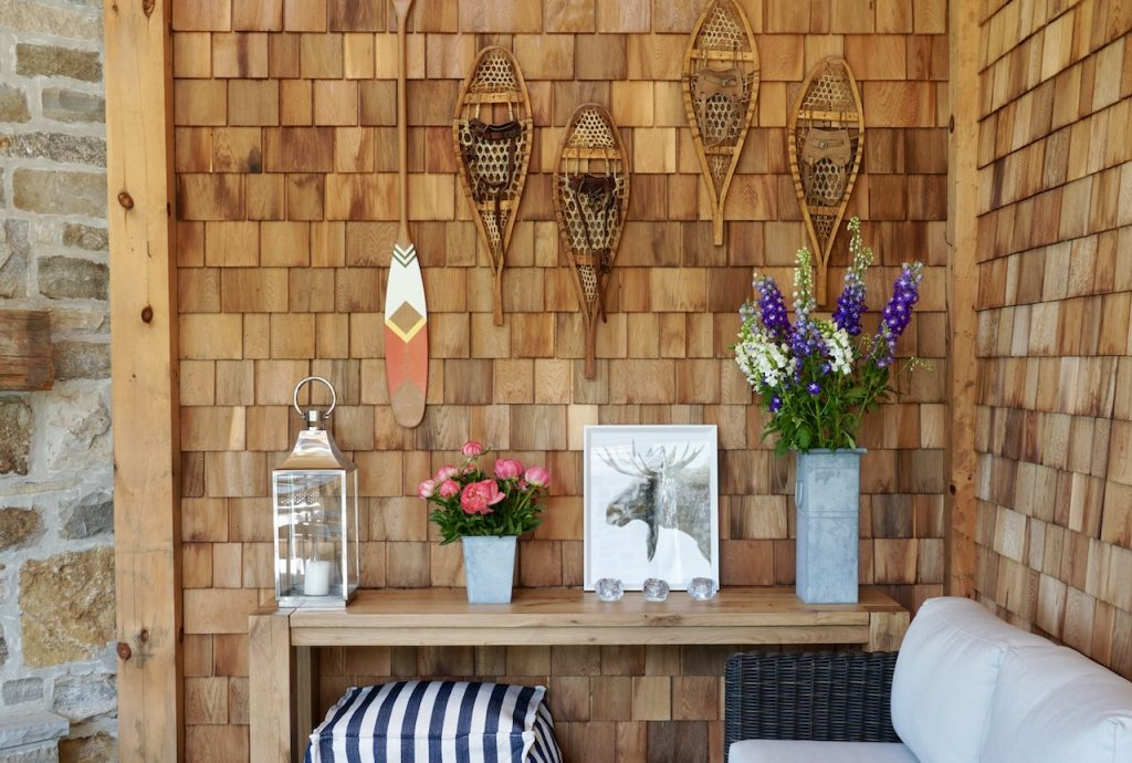 A vignettew of vintage and modern finds arranged on the signature wall