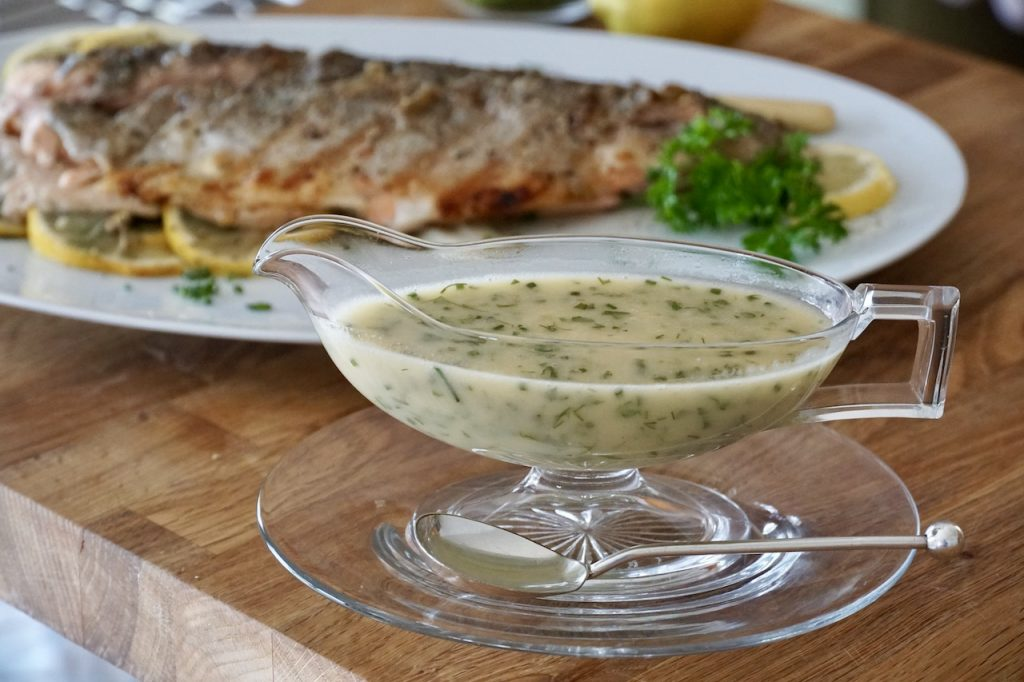 Beurre blanc flavoured with chopped fresh herbs