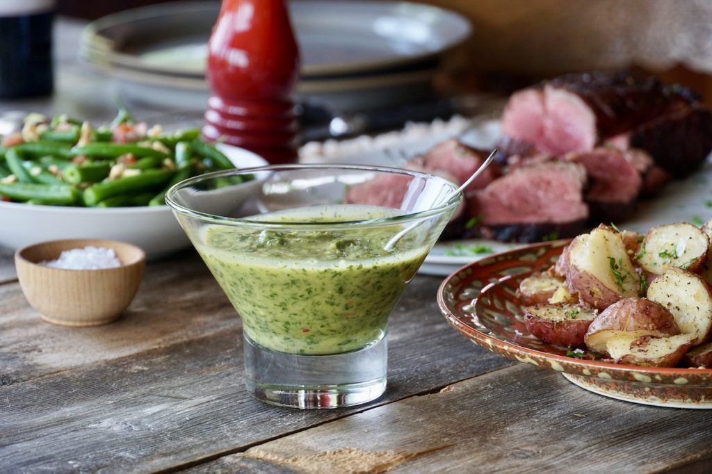 Chimichurri is an herb and garlic sauce that goes perfectly with our beef main course