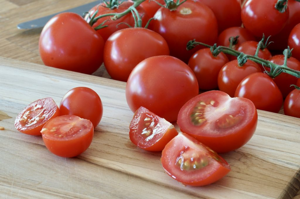 Halved and quartered fresh Ontario greenhouse tomatoes