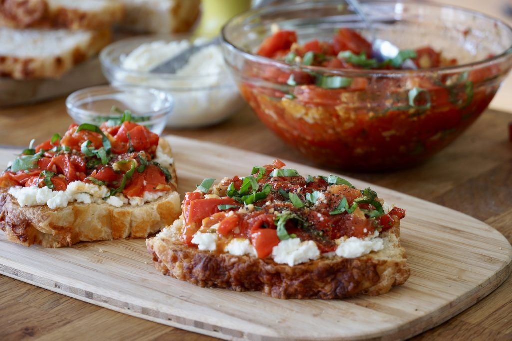 Toast with ricotta and Sheet Pan Tomatoes and Peppers