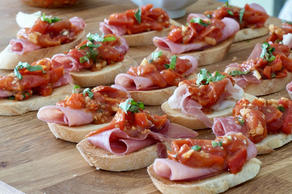Italian cold0cut bruschetta with Sheet Pan Tomatoes and Peppers