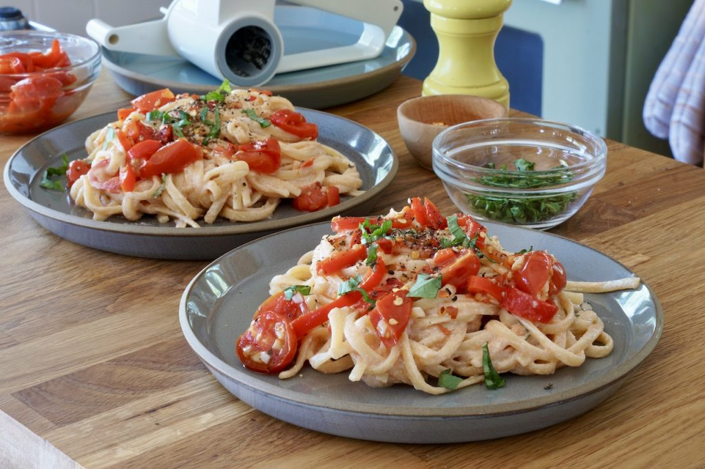 Creamy cheese linguine made with Sheet Pan Tomatoes and Peppers
