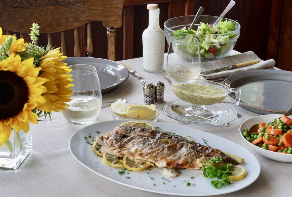 The fish served with herbed beurre blancbeurre blanc