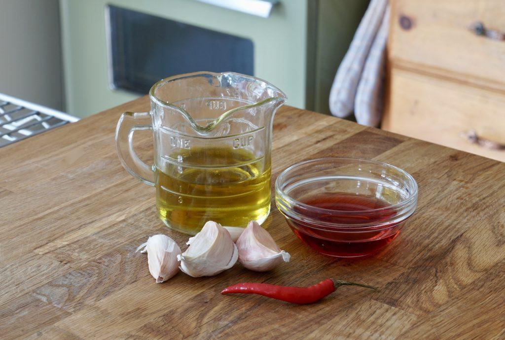 EVOO, red wine vinegar, garlic and a bird's eye pepper