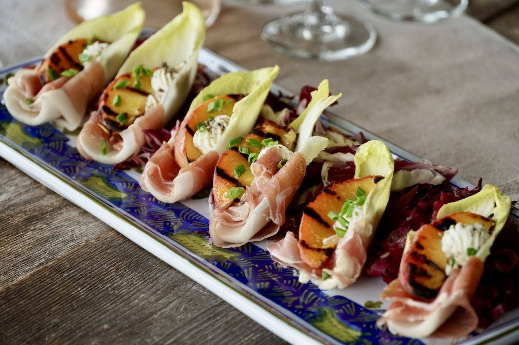 A tray of these easy party snacks, Peach and Prosciutto Appetizer